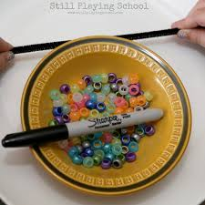 solar system bracelet craft for kids still playing