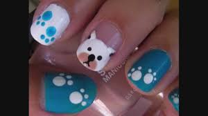 cute dog face on short nail design idea with blue and white colors