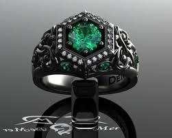 unique emerald engagement ring in black gold art deco halo