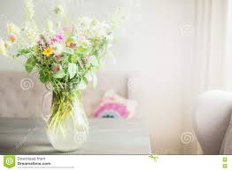 Flowers Home Decoration by Lovely Wild Flowers Bunch In Glass Vase On Table In Light Living