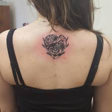 rose flower and deer antler tattoo on upper back