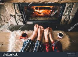 bare couple feet by cozy fireplace stock photo 345269126