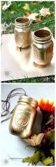 gold painted mason jars with spray paint diy