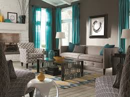 blue living room with brown furniture home design ideas