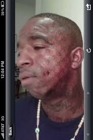 no idea why this man tattooed the gucci logo on his face but