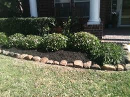 rocks bordering mulch landscaping pinterest garden ideas and