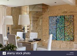 dining room with abstract painting on the wall and dining table