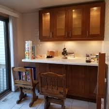 ikea adel medium brown kitchen cabinets staining chairs to match adel cabinet doors what color is