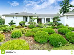 white one story house with nice landscape design stock photo