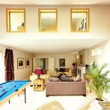 living room brown fabric sofa purple desk lamp plants bilyard
