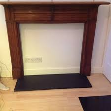 fireplace surround in oak and black granite hearth 75 in