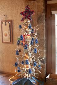 a country tree made with antlers and decorated with