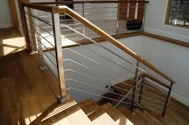 modern interior design with indoor stainless steel stair railing