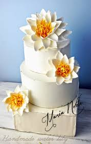 water lily wedding cake topper garden wedding close to a pond of