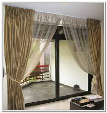 hanging curtains over sliding glass door sliding glass door curtains