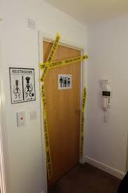 bathroom door crime scene barrier tape alien toilet signs