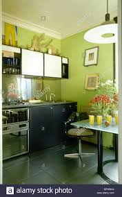white kitchen cabinets black tile floor green eat in kitchen with tile floor glass top dining table