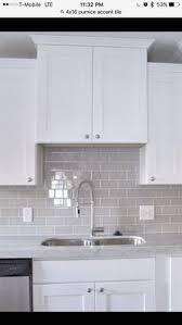 white kitchen cabinets backsplash smoke glass subway tile white shaker cabinets shaker cabinets