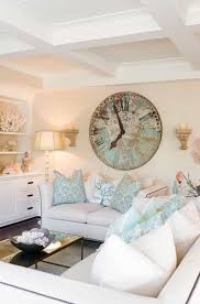 living room with white sofas and wall clock using a clock for