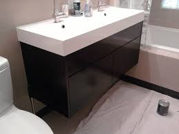 hanging black real wood vanity white granite countertop gray wall