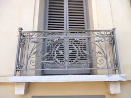 nice outdoor window balcony design using wrought iron railing