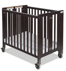 Solid Wood Mini Crib by Amazon Com Foundations Hideaway Compact Sized Folding Crib