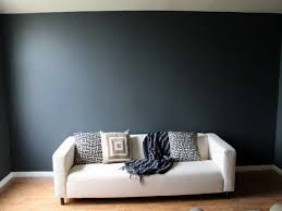 home design x black painted walls design with decorative pillows