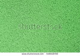 Textured Paint For Exterior Concrete Walls - background green stucco coated painted exterior stock photo