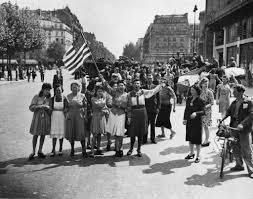 French And American Flags 70 Years Later Paris Prepares To Celebrate End Of Rule The