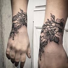 loving the placement of this floral wrist tattoo tattoo by