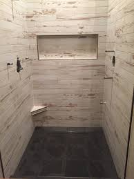 large white fiberglass tubs mixed black ceramic floor as well f wedi shower with 3x36 plank tile on wall black slate floor clean