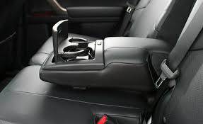 bmw x5 lexus gx 460 back seat arm rest and cup holders tesla