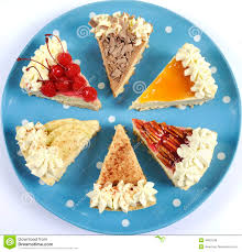 plate of thanksgiving food slices of thanksgiving pie on polka dot blue plate stock photo