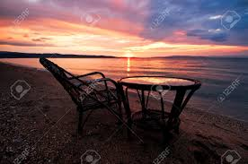Sunrise Sunset Table Old Table And Chair With Fantastic Sunset On The Backdrop
