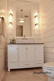 best 25 wall faucet ideas on pinterest wall mounted bathroom shiplap bathroom gets a major redo using long wall sconces travertine countertop vessel sink wall faucet and a beautiful ceiling pendant
