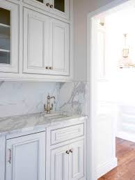 straight white kitchen cabinets with grey glaze for marble tile