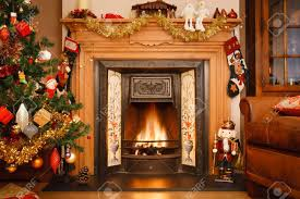 christmas fire place in a living room stock photo picture and christmas fire place in a living room stock photo 15812378