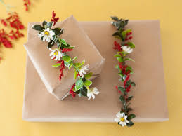How To Wrap Gifts - how to wrap a gift in floral garland how tos diy