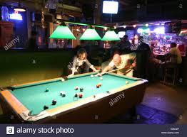 toledo ohio oliver house bar nightlife billiards pool table stock stock photo toledo ohio oliver house bar nightlife billiards pool table recreation bar couple man aiming woman