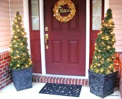 Front Porch Topiary Diy Tomato Cage And Garland Topiary Christmas Trees Lucy Designs