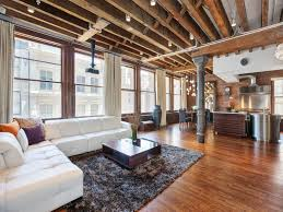 Industrial Apartment Open Plan Apartment With Exposed Wood Beams And Iron Columns