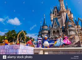 disney characters perform front cinderella castle magic