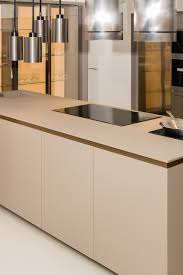 Kitchen top in FENIX NTM gives this kitchen a minimal interior