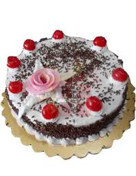 black forest cake topped with large cherry design send gift to