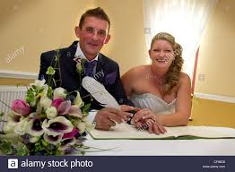 register wedding and groom signing wedding register stock photo 43844758 alamy