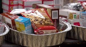 volunteers prep 600 thanksgiving food baskets