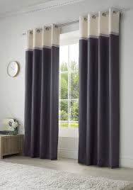 stunning eyelet curtains with a plain bottom and co ordinating border with modern geometric design these curtains have an eyelet top header making them