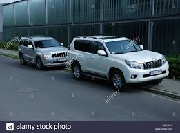 two suvs jeep grand cherokee 3 0 crd v6 and toyota land cruiser