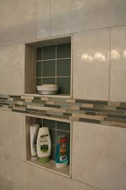 florentine porcelain tile and glass mosaic accent strips highlight