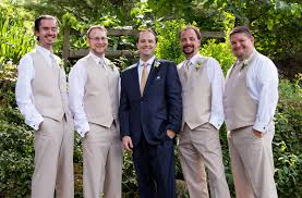 Groomsmen Groom in navy suit with champagne tie groomsmen in